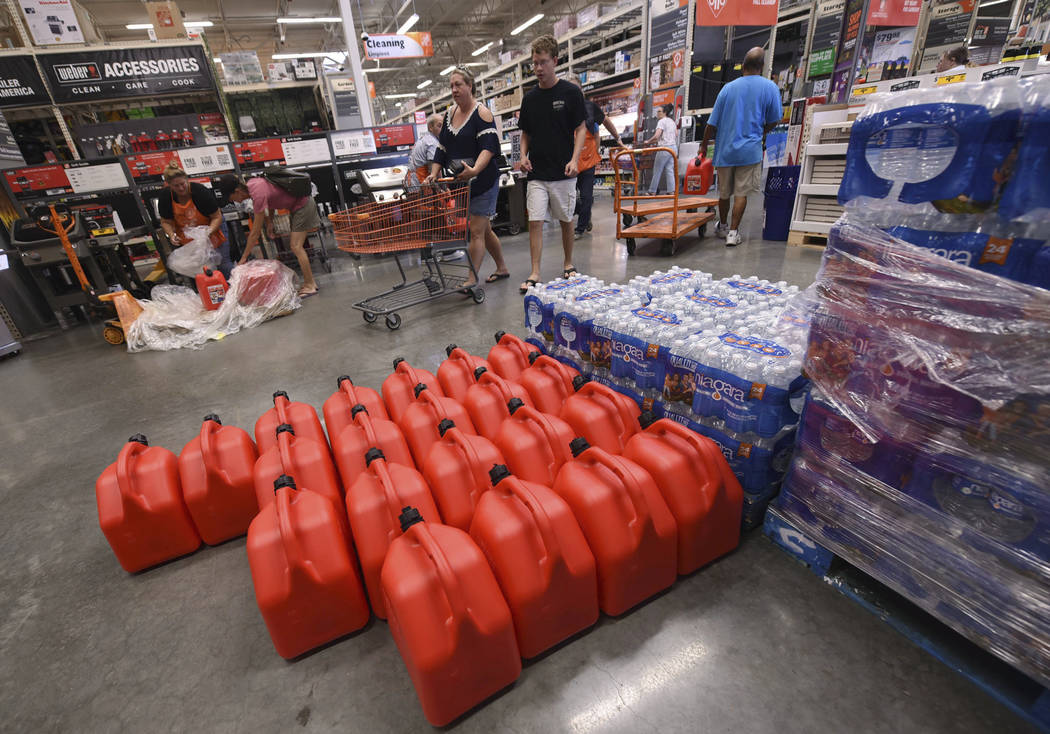 People buy supplies at The Home Depot on Monday, Sept. 10, 2018, in Wilmington, N.C. Florence rapidly strengthened into a potentially catastrophic hurricane on Monday as it closed in on North and ...