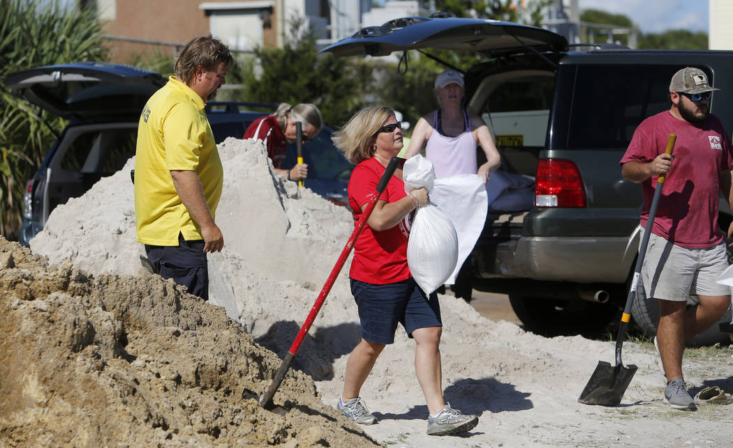 Residents of the Isle of Palms, S.C., fill sand bags at the Isle of Palms municipal lot where the city was giving away free sand in preparation for Hurricane Florence at the Isle of Palms S.C., Mo ...