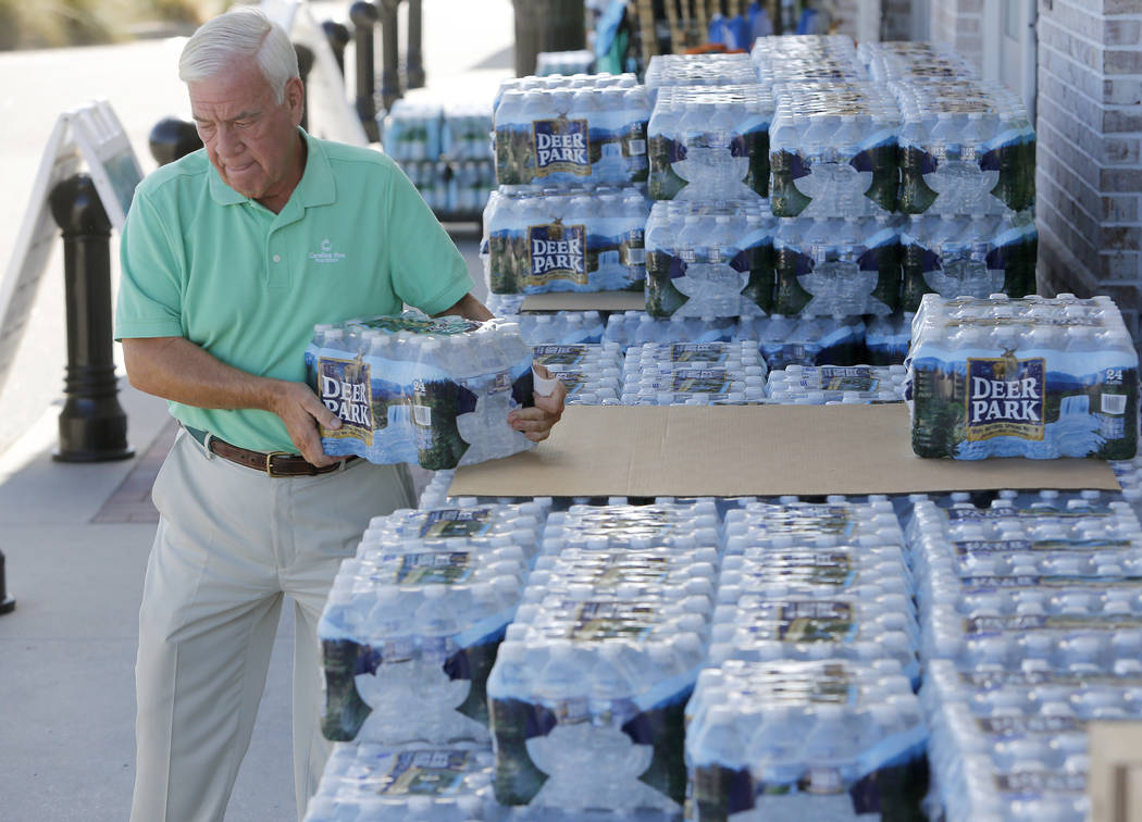 Larry Pierson, from the Isle of Palms, S.C., purchases bottled water from the Harris Teeter grocery store on the Isle of Palms in preparation for Hurricane Florence at the Isle of Palms S.C., Mond ...