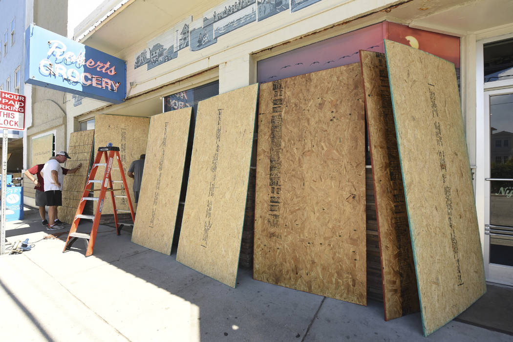 Roberts Grocery Store in Wrightsville Beach, N.C. boards up it's windows as they prepare for Hurricane Florence Monday, Sept. 10, 2018. Hurricane Florence now a category 3 hurricane is expected to ...