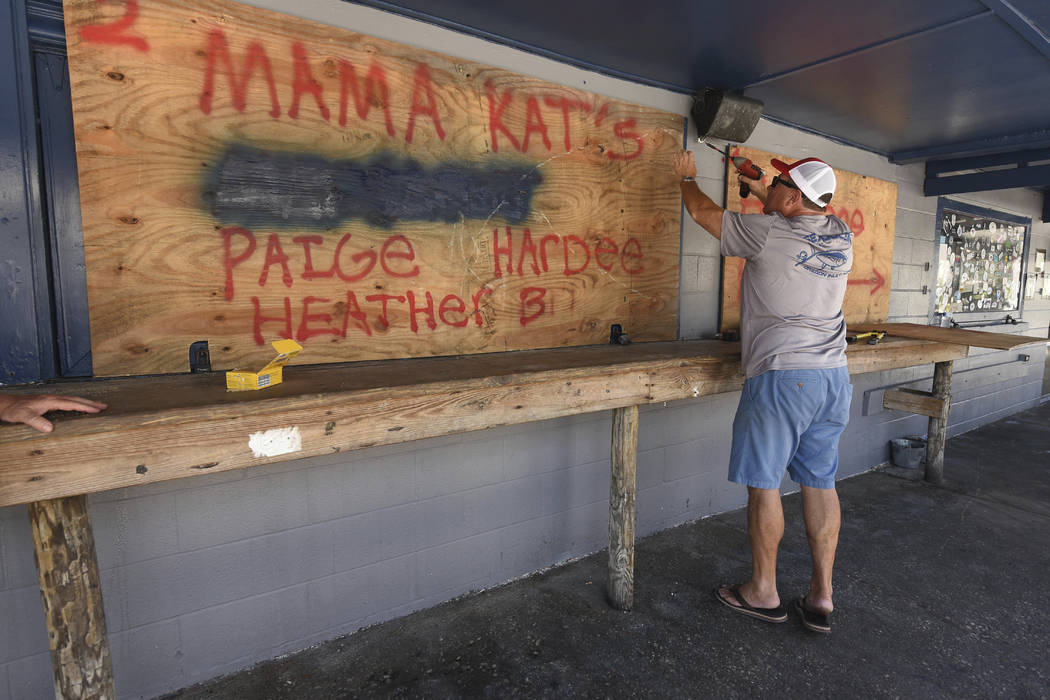 Rob Quinn boards up Lagerheads Tavern in Wrightsville Beach, N.C. as they prepare for Hurricane Florence Monday, Sept. 10, 2018. Hurricane Florence now a category 3 hurricane is expected to make l ...