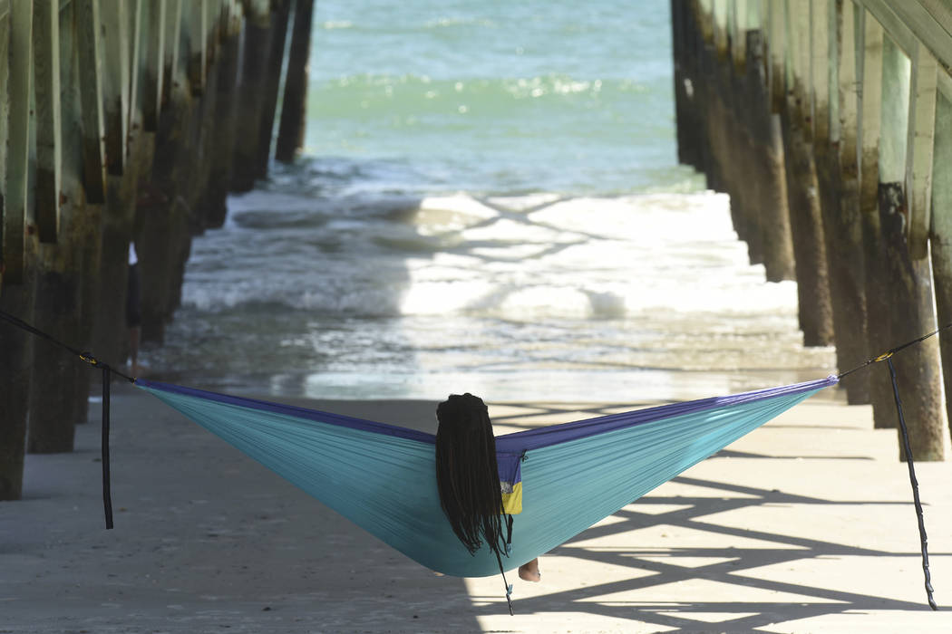 Alexis Browning enjoyed the sunny weather and waves along Wrightsville Beach, N.C. as others prepared for Hurricane Florence Monday, Sept. 10, 2018. Hurricane Florence now a category 3 hurricane i ...