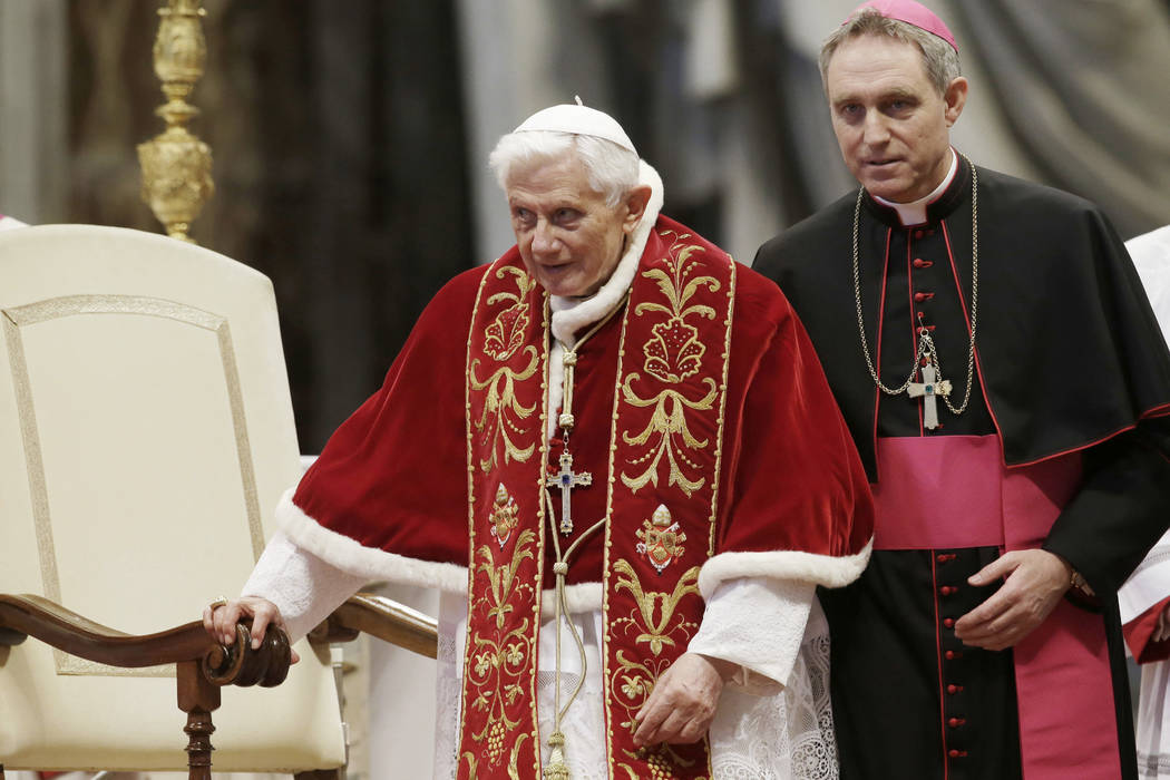 Pope Benedict XVI flanked by personal secretary Archbishop Georg Gaenswein during a Mass to mark the 900th anniversary of the Order of the Knights of Malta in St. Peter's Basilica at the Vatican o ...