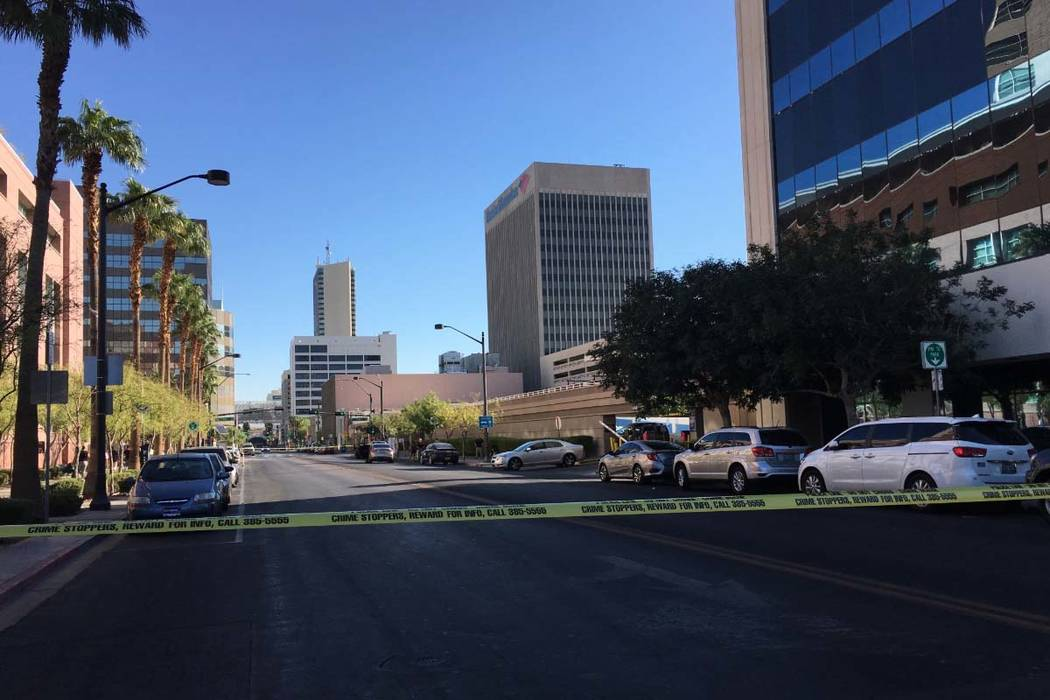 Las Vegas police investigate after a woman was struck by a vehicle in the 200 block of Lewis Avenue, in front of the Regional Justice Center, in downtown Las Vegas on Tuesday, Sept. 11, 2018. (Mar ...