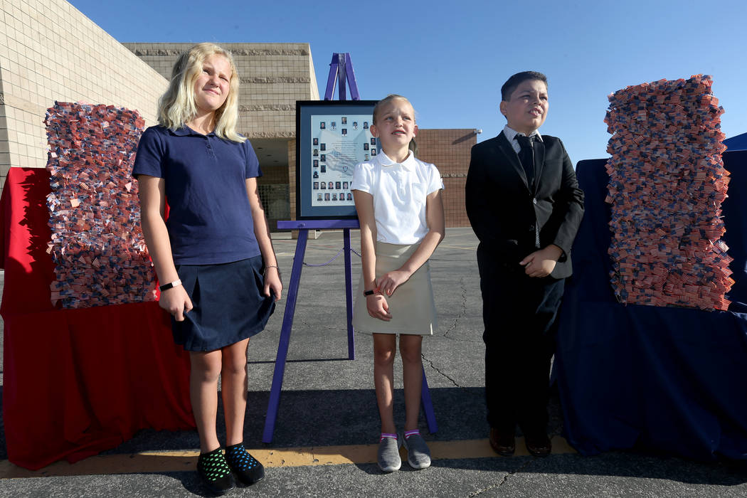 Fifth graders, from left, Alivia Taylor, 10, Savannah Terasa, 9, and Andrew Gomez, 10, talk to a reporter after a 9/11 observance at Joseph M. Neal STEAM Academy in Las Vegas Tuesday, Sept. 11, 20 ...