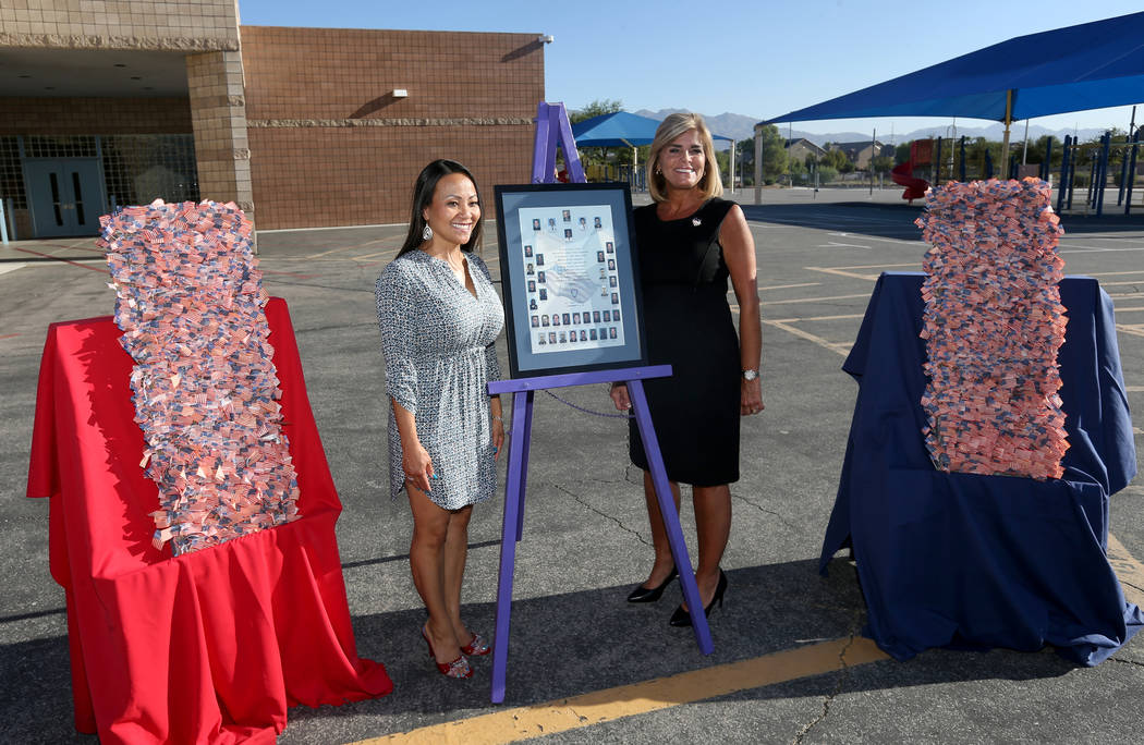 Assistant Principal Stephanie Auclair, left, and Principal Denise Murray after a 9/11 observance at Joseph M. Neal STEAM Academy in Las Vegas Tuesday, Sept. 11, 2018. Murray and her husband, a for ...