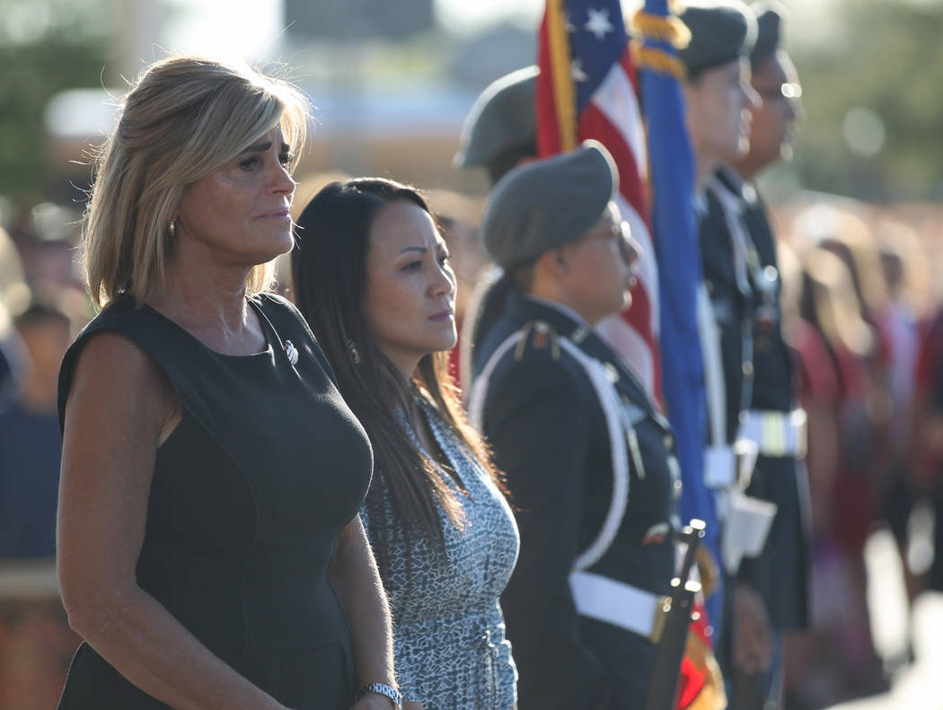 Principal Denise Murray, left, and Assistant Principal Stephanie Auclair during a 9/11 observance at Joseph M. Neal STEAM Academy in Las Vegas Tuesday, Sept. 11, 2018. Murray and her husband, a fo ...