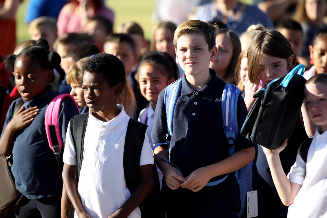 Students during a 9/11 observance at Joseph M. Neal STEAM Academy in Las Vegas Tuesday, Sept. 11, 2018. Principal Denise Murray and her husband, a former Port Authority Police lieutenant who ...