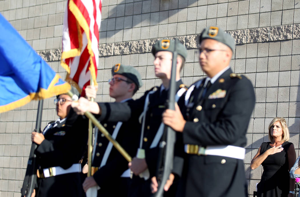 Principal Denise Murray, right, with Cheyenne High School Army ROTC Color Guard during a 9/11 observance at Joseph M. Neal STEAM Academy in Las Vegas Tuesday, Sept. 11, 2018. Murray, whose husband ...