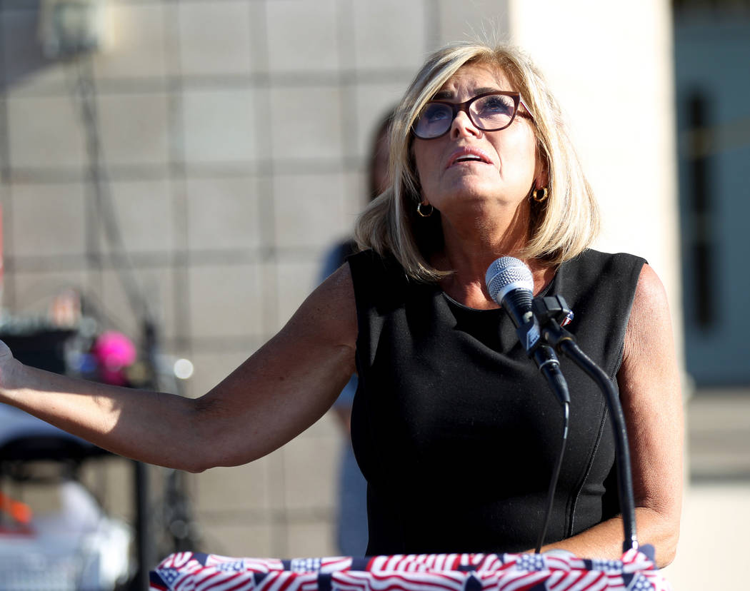 Principal Denise Murray speaks during a 9/11 observance at Joseph M. Neal STEAM Academy in Las Vegas Tuesday, Sept. 11, 2018. Murray and her husband, a former Port Authority Police lieutenant who ...