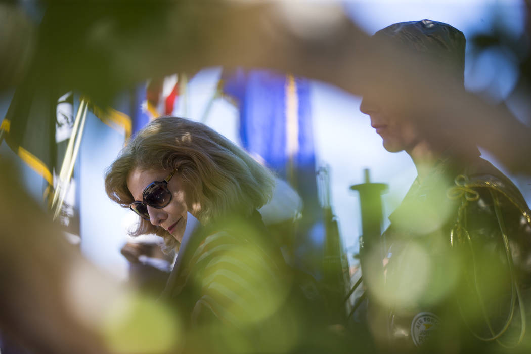 Cathy Navin looks at a photo of teacher Barbara Edwards during the annual rededication ceremony remembering victims of the 9/11 terrorist attacks, which claimed the life of Edwards, at the memoria ...