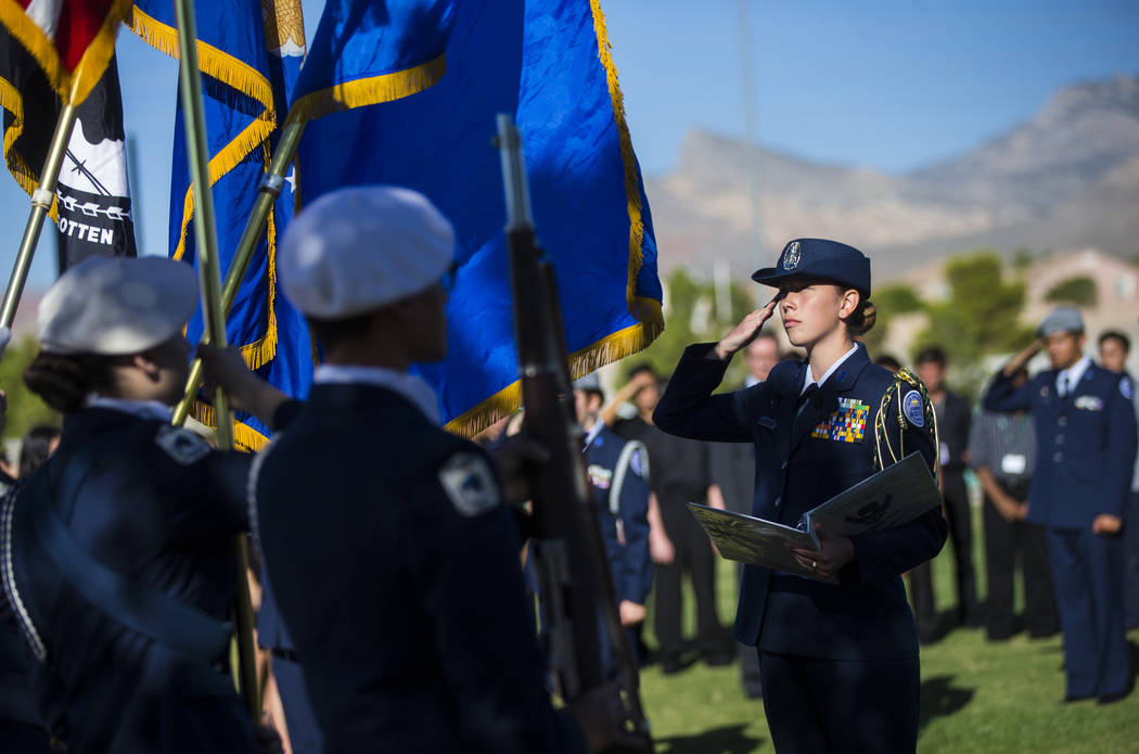 Alexandra Vasknetz, corps commander at the Palo Verde High School Air Force JROTC, watches as the flag is lowered and removed during the annual rededication ceremony remembering victims of the 9/1 ...