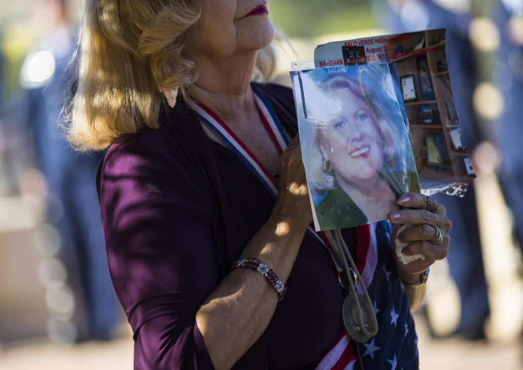 Cathy Navin holds a photo of teacher Barbara Edwards during the annual rededication ceremony remembering victims of the 9/11 terrorist attacks, which claimed the life of Edwards, at the memorial i ...
