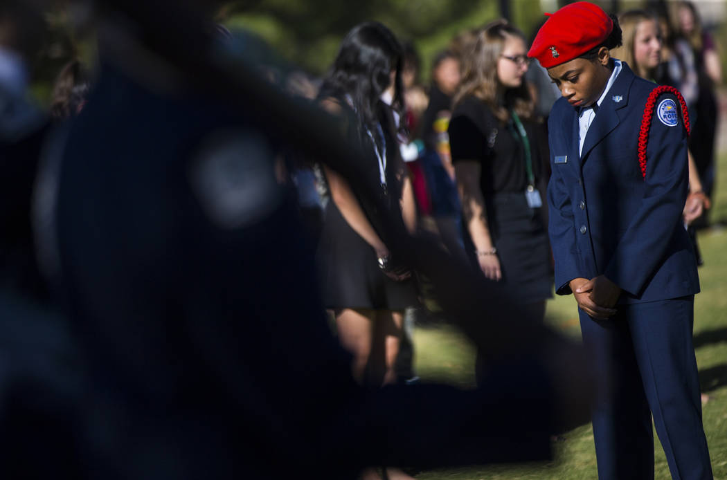 Members of the Palo Verde High School Air Force JROTC stand for a moment of silence during the annual rededication ceremony remembering victims of the 9/11 terrorist attacks, which claimed the lif ...