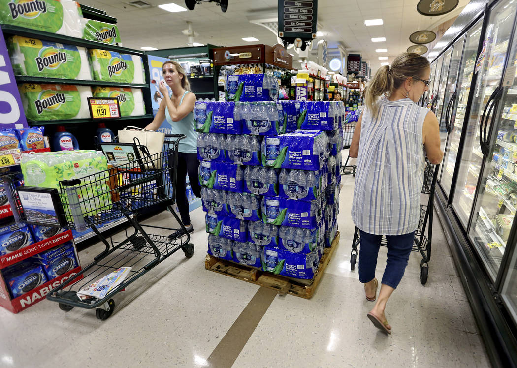 People shop at the Harris Teeter, filling up on water and supplies as Hurricane Florence becomes a threat to the coast Monday, Sept. 10, 2018, in Charleston, S.C. (Grace Beahm Alford/The Post And ...