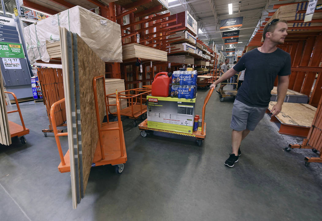 Alex Gilewicz buys supplies at The Home Depot on Monday, Sept. 10, 2018, in Wilmington, N.C. Residents of Wilmington and Southeastern N.C. Florence rapidly strengthened into a potentially catastro ...