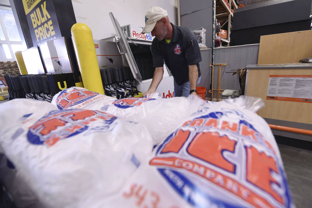Mike Herring with Frank's Ice Company unloads another pallet of ice as people buy supplies at The Home Depot on Monday, Sept. 10, 2018, in Wilmington, N.C. Hurricane Florence rapidly strengthened ...