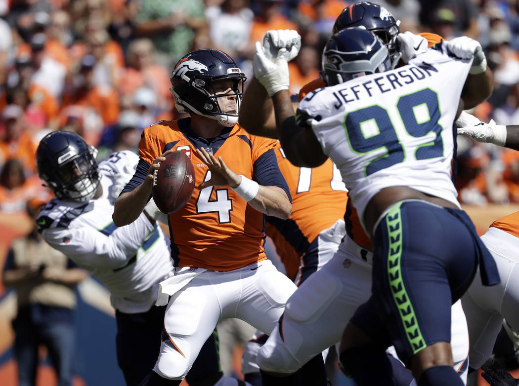 FILE - In this Sunday, Sept. 9, 2018, file photo, Denver Broncos quarterback Case Keenum throws a pass during the first half of an NFL football game against the Seattle Seahawk in Denver. Maybe t ...