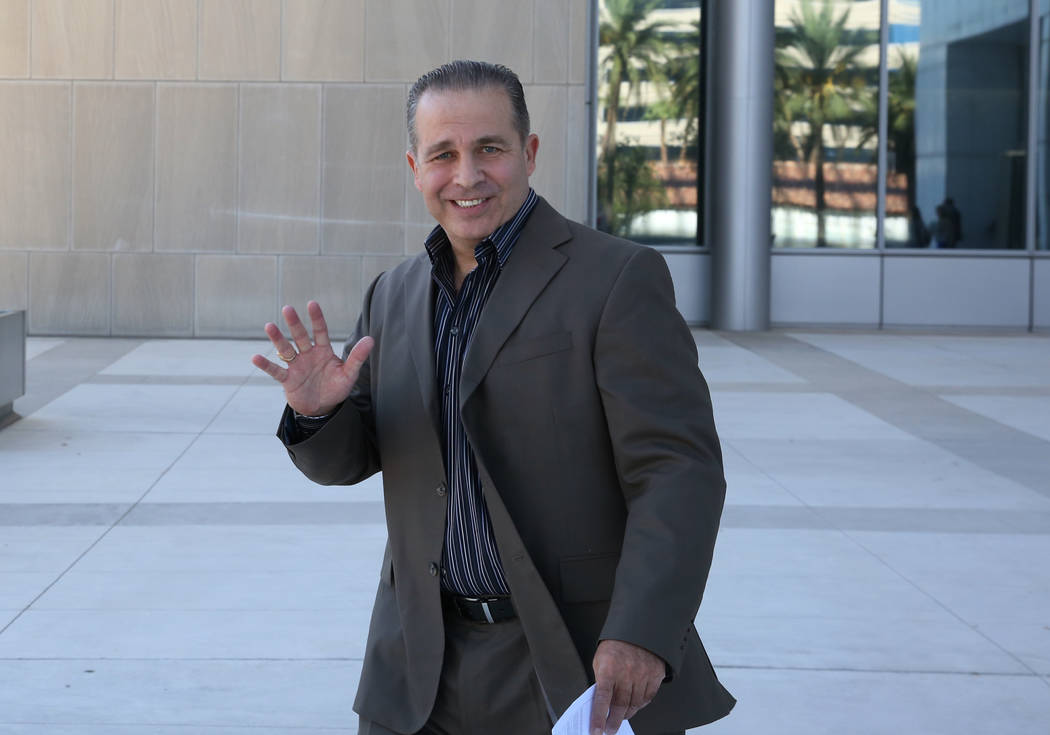 Peter Santilli Jr., a defendant charged in the case involving the armed standoff in Bunkerville, waves as he leaves the Lloyd George U.S. Courthouse on Tuesday, Sept. 11, 2018, in Las Vegas. (Bizu ...