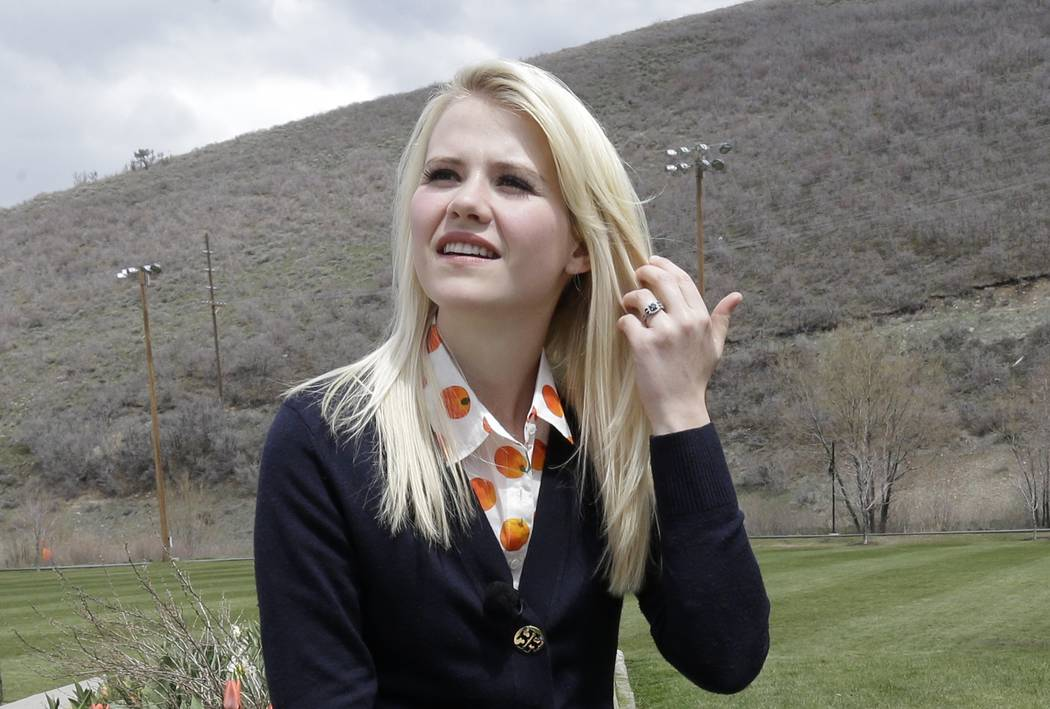 Elizabeth Smart looks on before an interview Tuesday, May 7, 2013, in Park City, Utah. Smart was kidnapped from her bedroom in Salt Lake City when she was 14. She was freed nine months later when ...