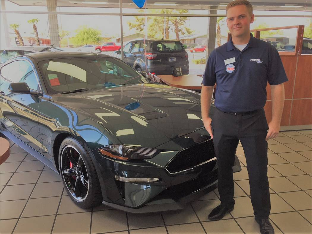 Friendly Ford sales consultant Isaac Roberts is seen with the 2019 Mustang Bullitt in the showroom of the dealership at 660 N. Decatur Blvd. (Friendly Ford)