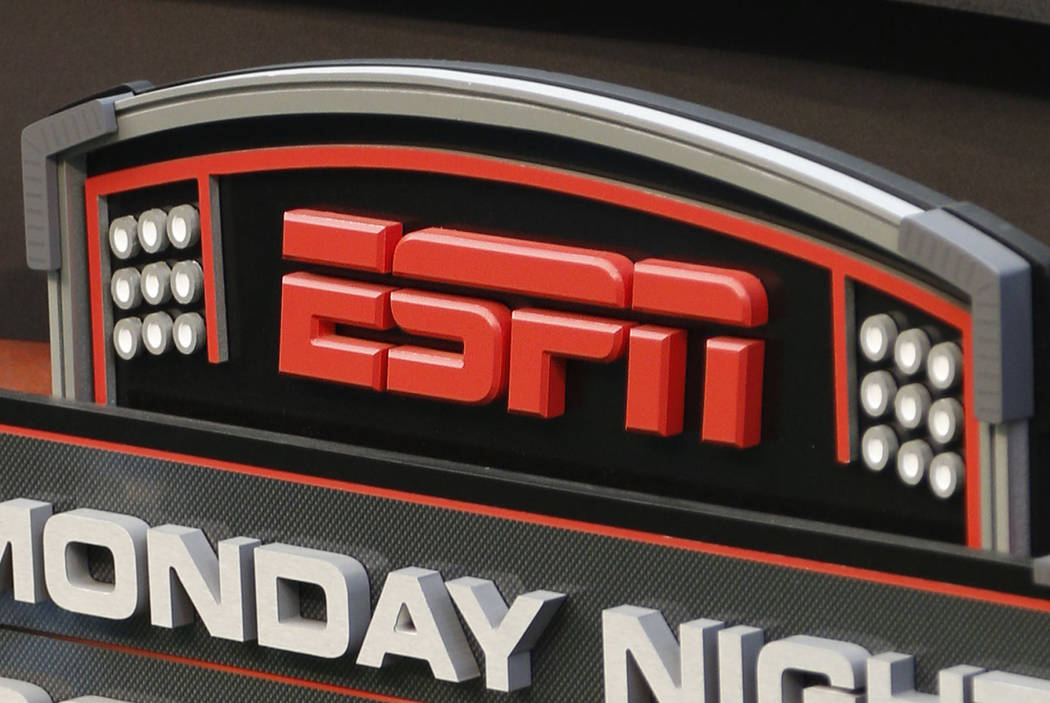 This Sept. 16, 2013, file photo shows the ESPN logo prior to an NFL football game between the Cincinnati Bengals and the Pittsburgh Steelers, in Cincinnati. (AP Photo/David Kohl, File)