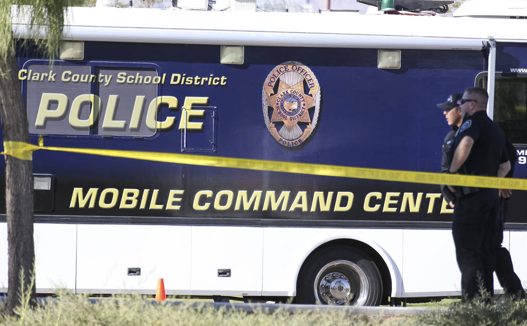 Clark County School District police keep watch outside their mobile command center while investigating a homicide at Canyon Springs High School in North Las Vegas on Tuesday, Sept. 11, 2018. Richa ...