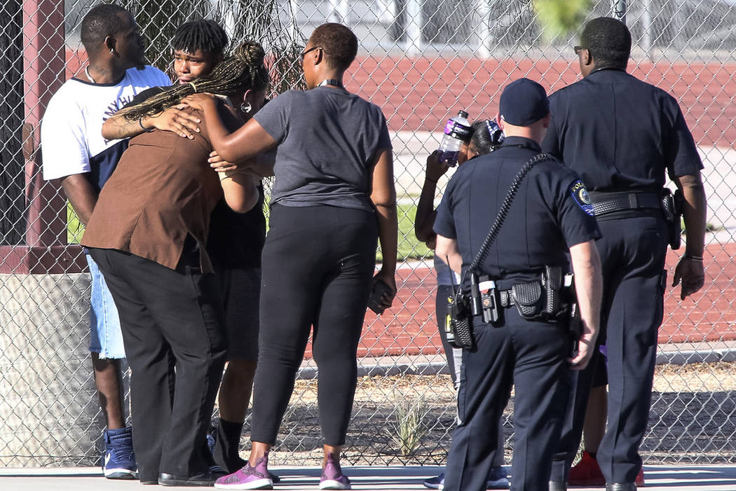 A woman is consoled in the parking lot as police investigate a homicide at Canyon Springs High School in North Las Vegas on Tuesday, Sept. 11, 2018. Richard Brian Las Vegas Review-Journal @vegasph ...