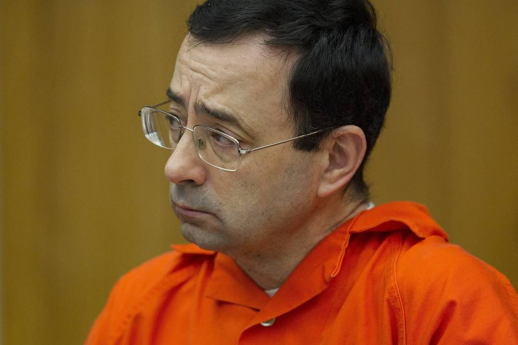 Larry Nassar appears for his sentencing at Eaton County Circuit Court in Charlotte, Mich. on Jan. 31, 2018. Lawyers rushed to meet a Monday, Sept. 10, deadline to file lawsuits against Michigan St ...