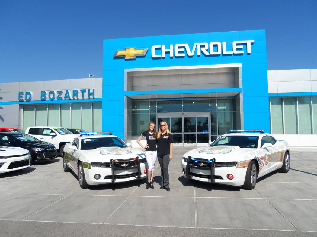 Ed Bozarth Nevada Chevrolet displayed two Fueled by the Fallen memorial vehicles on Tuesday. Fueled by the Fallen spokesperson Kayla Kalisz, left, and Ed Bozarth executive assistant and Fueled by ...