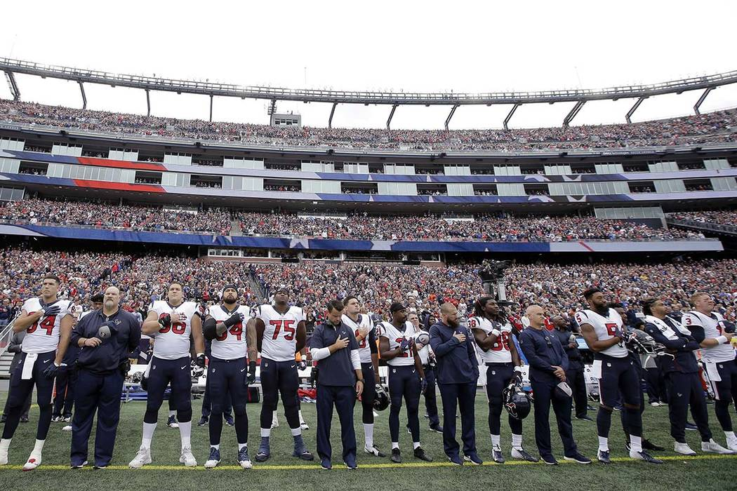 Houston Texans players stand during the national anthem before an NFL football game against the New England Patriots, Sunday, Sept. 9, 2018, in Foxborough, Mass. (AP Photo/Steven Senne)