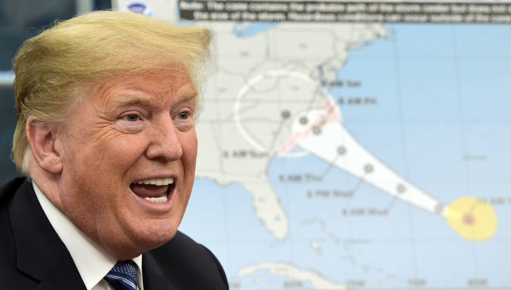 President Donald Trump talks about Hurricane Florence following a briefing in the Oval Office of the White House in Washington, Tuesday, Sept. 11, 2018. (AP Photo/Susan Walsh)