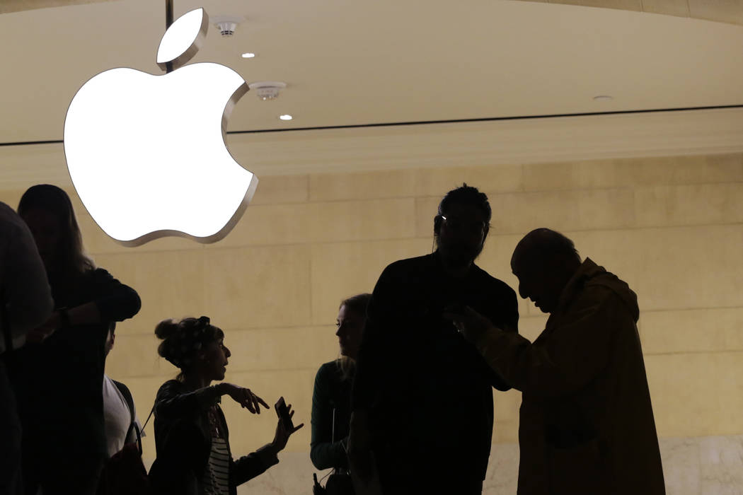 In this May 31, 2018, file photo customers enter the Apple store in New York. Apple is expected to unveil its biggest and most expensive iPhone yet on Wednesday, Sept. 12, along with two smaller, ...