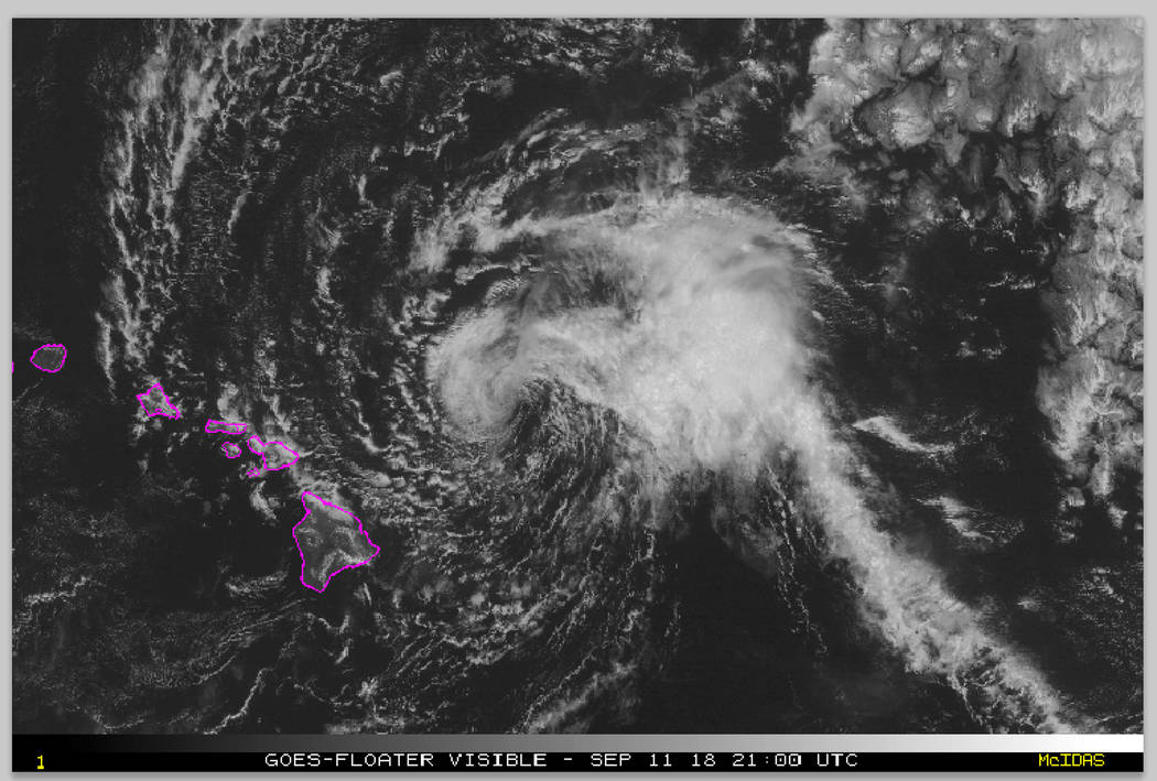 This satellite image made available the National Oceanic and Atmospheric Administration (NOAA) shows Tropical Storm Olivia east of the main islands of Hawaii at 11 a.m. Hawaii time Tuesday, Sept. ...