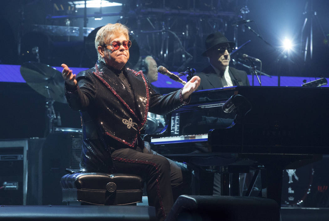 "Elton John performs in concert during the opening night of his ""Farewell Yellow Brick Road World Tour"" at the PPL Center on Saturday, Sept. 8, 2018, in Allentown, Pa. (Owen Sweeney/Invision/AP)"