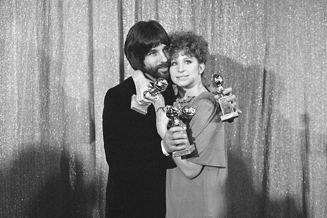 "Jon Peters and Barbra Streisand hold their awards at the Jan. 29, 1977 Golden Globe Awards in Los Angeles. They won four awards for ""A Star Is Born."" Peters is a credited producer of the new ""A St ..."