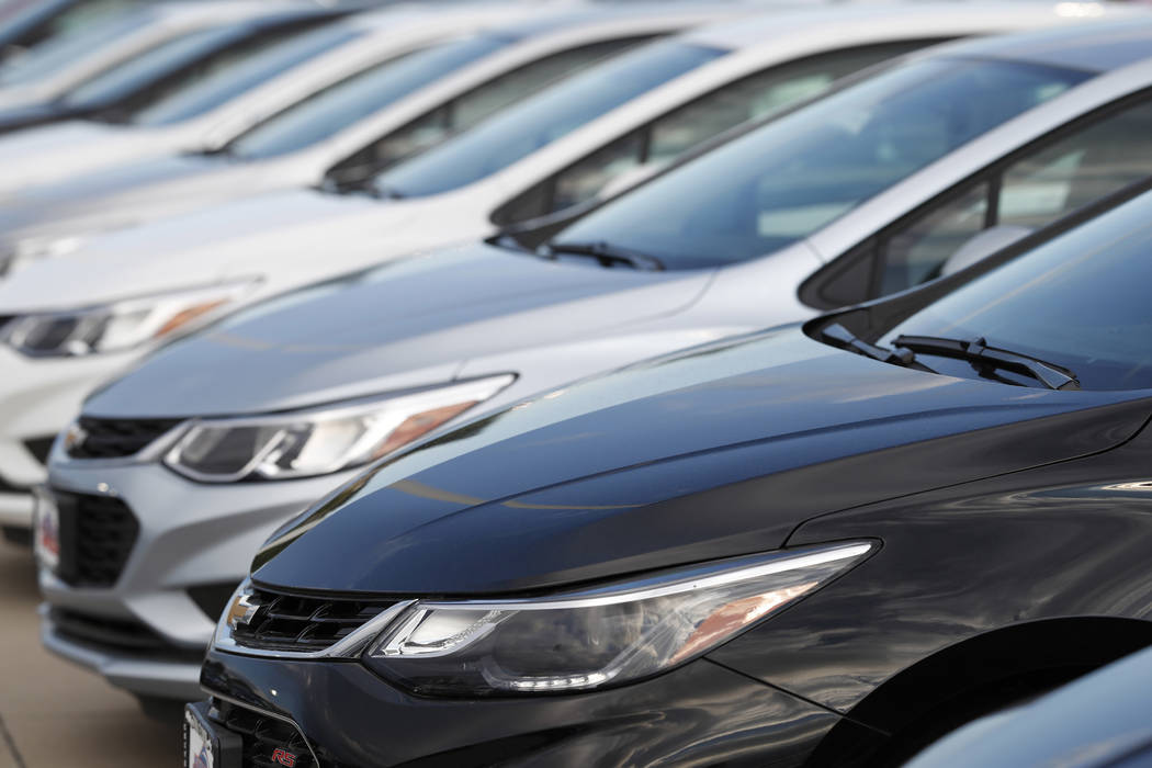 A row of unsold 2018 Cruze sedans at a Chevrolet dealership in Englewood, Colo. on Sunday, June 24, 2018. (AP Photo/David Zalubowski)