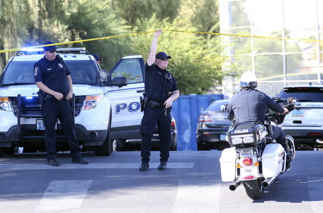 North Las Vegas Police police investigate a homicide at Canyon Springs High School in North Las Vegas on Tuesday, Sept. 11, 2018. Richard Brian Las Vegas Review-Journal @vegasphotograph