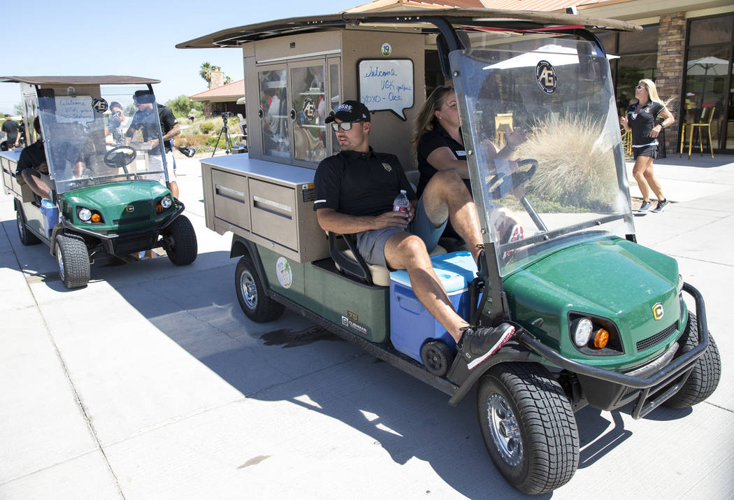 Vegas Golden Knights center Ryan Carpenter (40) takes a ride on the drink cart during the Vegas Golden Knights Inaugural Charity Golf Classic at BearÕs Best golf course in Las Vegas on Tuesda ...