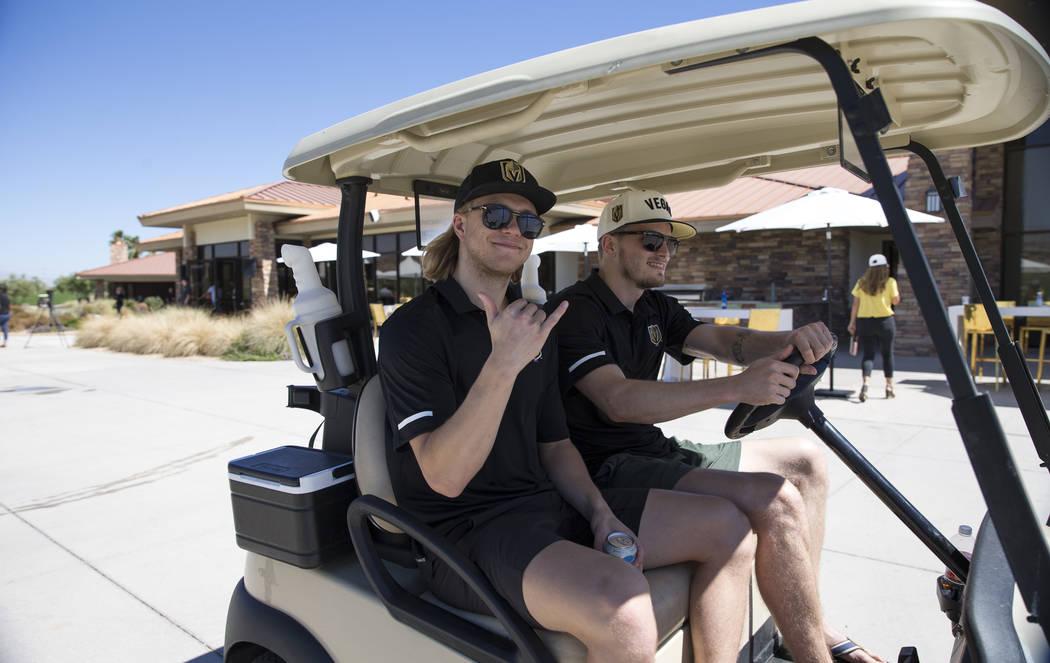 Vegas Golden Knights center William Karlsson, left, and goaltender Oscar Dansk (35) ride in a golf cart during the Vegas Golden Knights Inaugural Charity Golf Classic at BearÕs Best golf cour ...