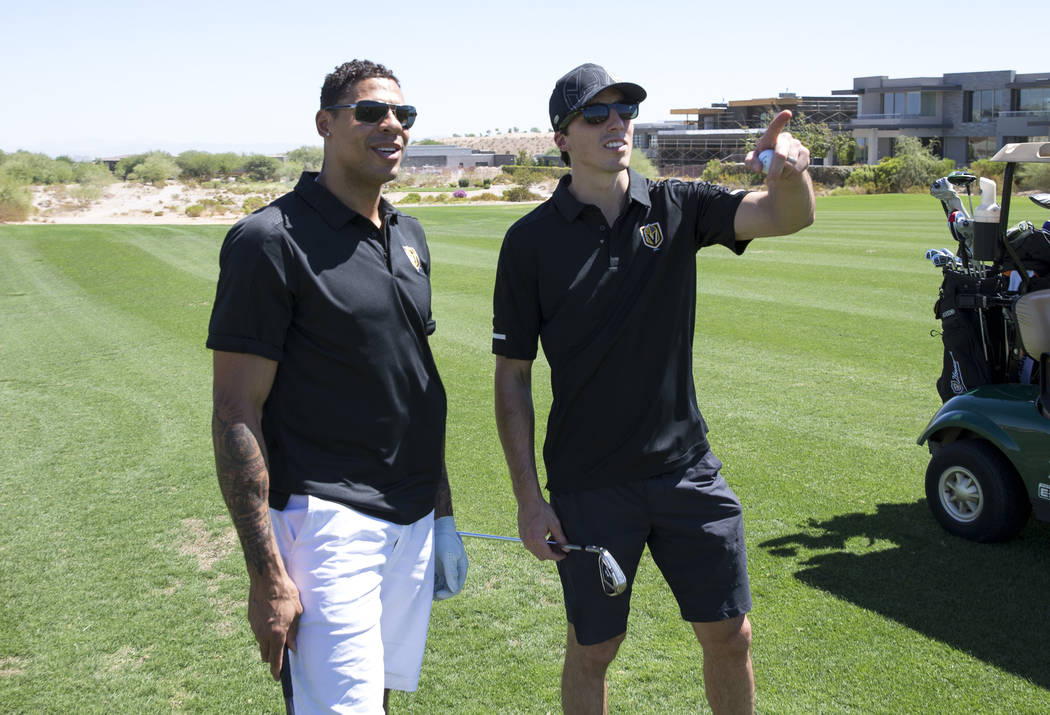 Vegas Golden Knights right wing Ryan Reaves, left, and Knights goaltender Marc-Andre Fleury (29) on the fairway during the Vegas Golden Knights Inaugural Charity Golf Classic at BearÕs Best g ...