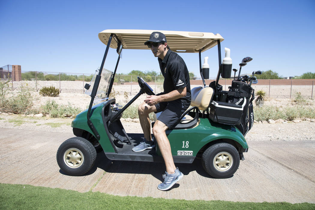 Vegas Golden Knights goaltender Marc-Andre Fleury drives a golf cart while participating in the Vegas Golden Knights Inaugural Charity Golf Classic at BearÕs Best golf course in Las Vegas on ...