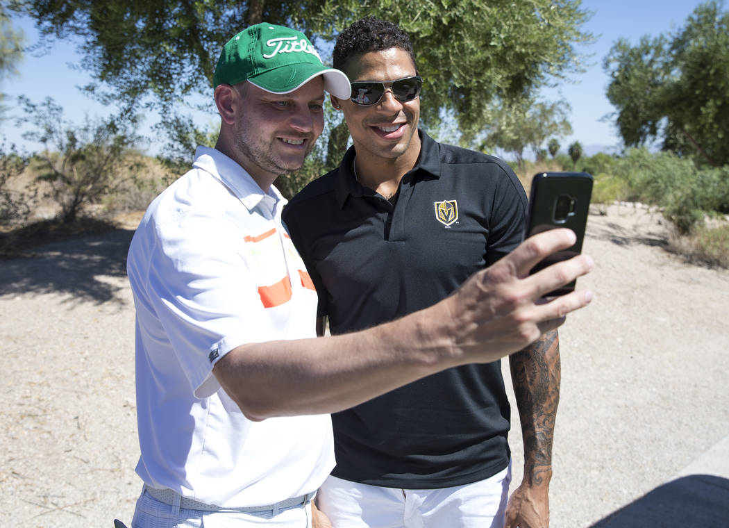 Vegas Golden Knights right wing Ryan Reaves, right, takes a selfie with Knights fan Harley Carbery during the Vegas Golden Knights Inaugural Charity Golf Classic at BearÕs Best golf course in ...