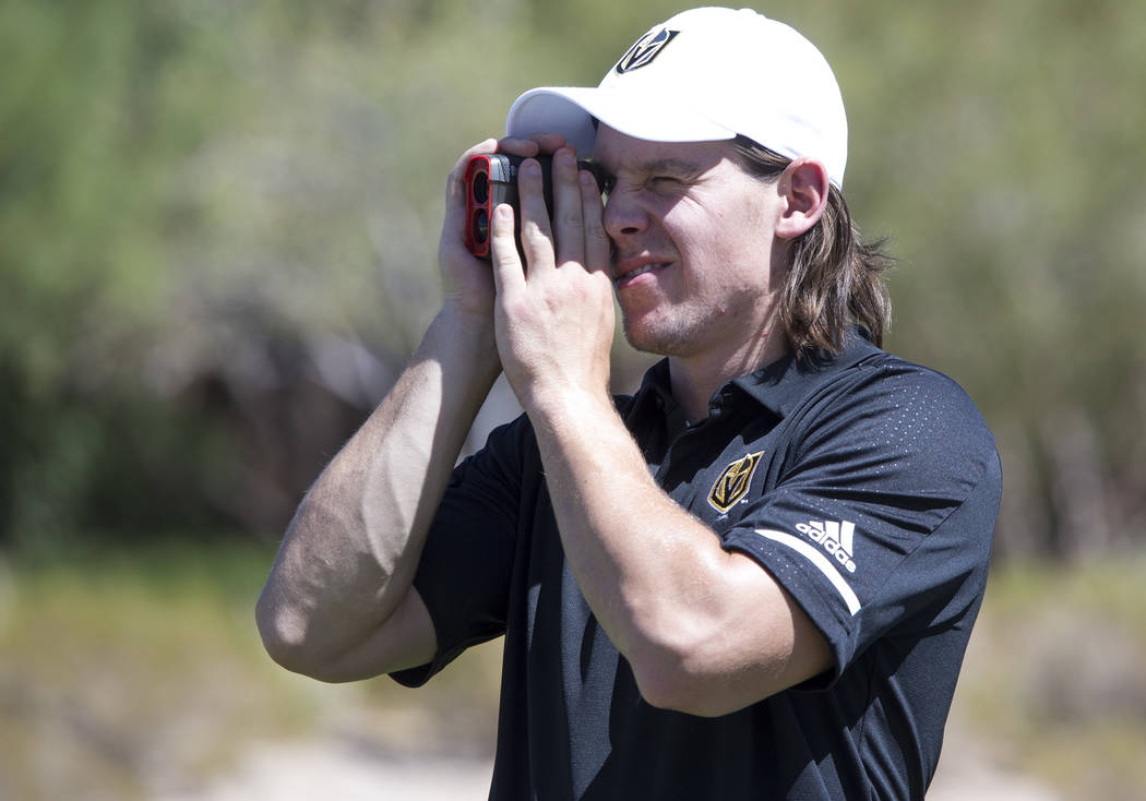 Vegas Golden Knights left wing Erik Haula measures the fairway before teeing off during the Vegas Golden Knights Inaugural Charity Golf Classic at BearÕs Best golf course in Las Vegas on Tues ...