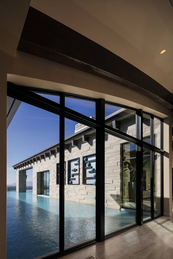 The 5,900-square-foot pool wraps around the home. (Shay Velich)