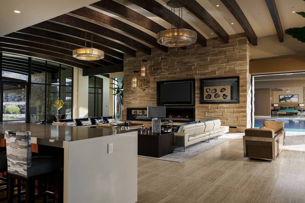 The living room has disappearing walls that connect the outdoors with the indoors. (Shay Velich)