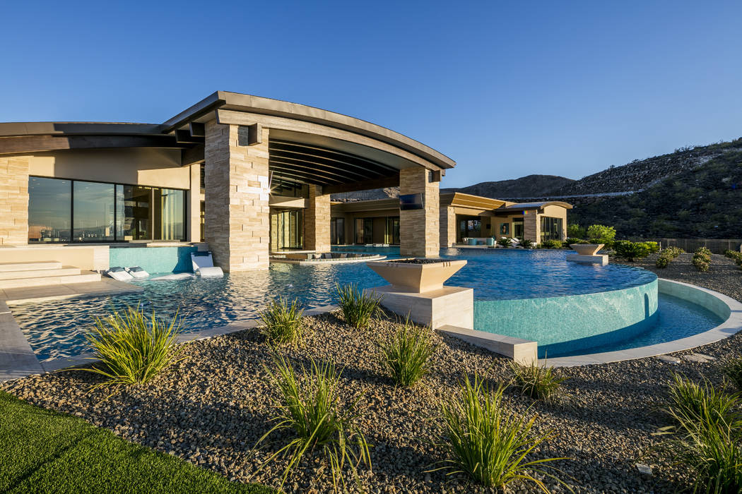 The pool area features a cold spa cold plunge pool. (Sun West Custom Homes)