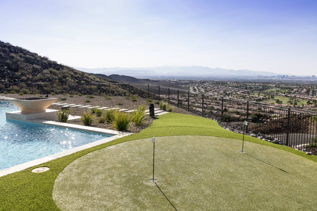 There is a putting green by the pool. (Sun West Custom Homes)