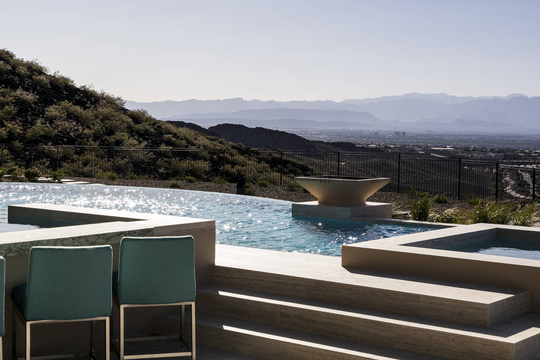 The pool area features a spa. (Sun West Custom Homes)