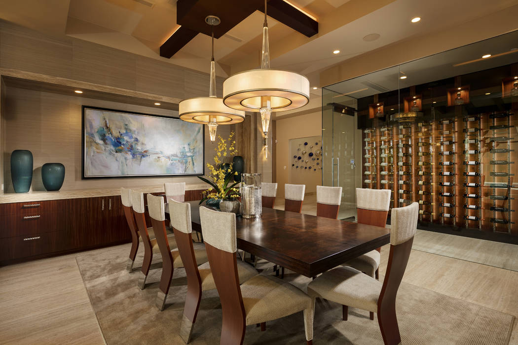The formal dining room has a wine wall. (Shay Velich)